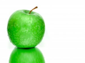 green apple on desk